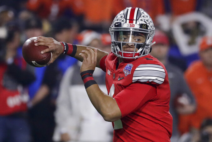 Ohio State quarterback Justin Fields throws a pass against Clemson during the first half of the Fiesta Bowl NCAA college football playoff semifinal Saturday, Dec. 28, 2019, in Glendale, Ariz. (AP Photo/Rick Scuteri)