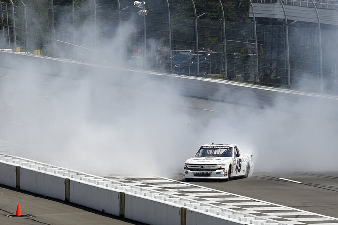 Ross Chastain does a burnout after winning a NASCAR Truck Series auto race, Saturday, July 27, 2019, in Long Pond, Pa. (AP Photo/Derik Hamilton)