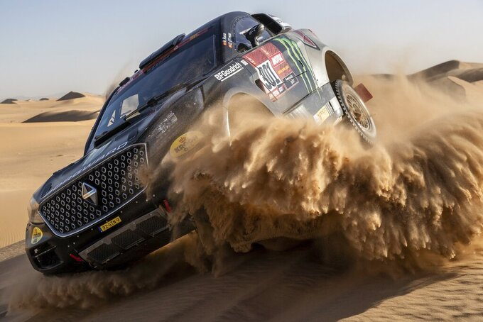 Driver Nani Roma, of Spain, and co-driver Daniel Oliveras, of Spain, race their Borgward during stage eight of the Dakar Rally in Wadi Al Dawasir, Saudi Arabia, Monday, Jan. 13, 2020. (AP Photo/Bernat Armangue)