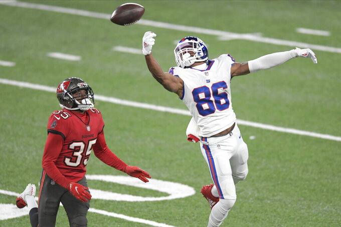 New York Giants' Darius Slayton, right, cannot make the catch in front of Tampa Bay Buccaneers' Jamel Dean during the second half of an NFL football game, Monday, Nov. 2, 2020, in East Rutherford, N.J. (AP Photo/Bill Kostroun)