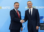 Poland's President Andrzej Duda is greeted by NATO Secretary General Jens Stoltenberg before a summit of heads of state and government at NATO headquarters in Brussels on Wednesday, July 11, 2018. NATO leaders gather in Brussels for a two-day summit to discuss Russia, Iraq and their mission in Afghanistan. (AP Photo/Francois Mori)