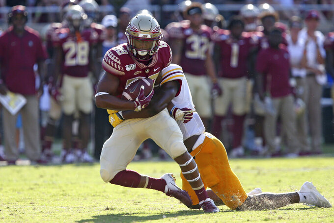 Florida State's Tre'Shaun Harrison, left, is tackled by Louisiana-Monroe's Keilos Swinney in the first quarter of an NCAA college football game Saturday, Sept. 7, 2019 in Tallahassee Fla. (AP Photo/Steve Cannon)v