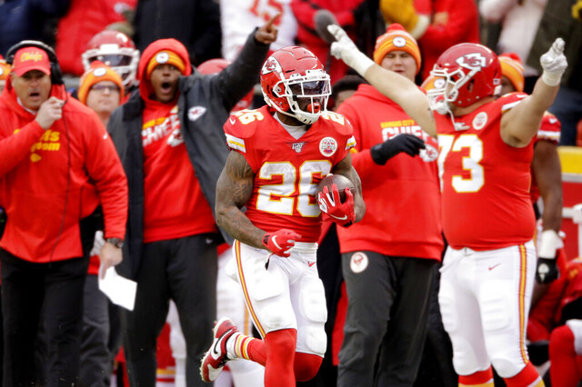 Kansas City Chiefs running back Damien Williams (26) runs for a touchdown during the second half of an NFL football game against the Los Angeles Chargers in Kansas City, Mo., Sunday, Dec. 29, 2019. (AP Photo/Charlie Riedel)