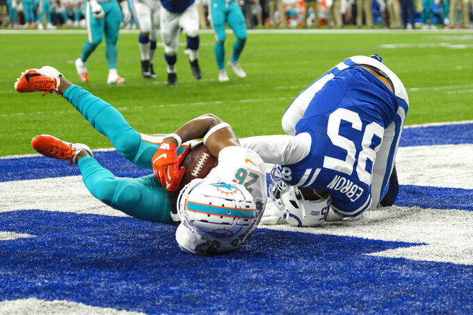 Dolphins defensive back Steven Parker (26) rolls away with the ball after stripping it in the end zone from Indianapolis Colts tight end Eric Ebron (85) during the first half of an NFL football game in Indianapolis, Sunday, Nov. 10, 2019. The play was rule an interception by Parker. (AP Photo/AJ Mast)