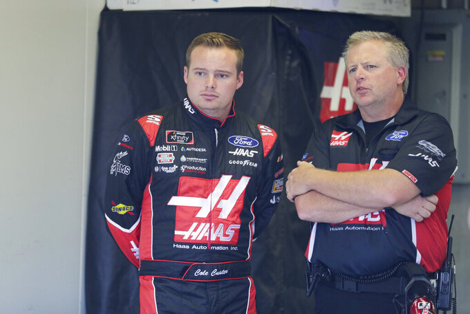 NASCAR Xfinity Series driver Cole Custer talks with a member of his crew before the start of NASCAR Xfinity auto racing practice at Indianapolis Motor Speedway, Friday, Sept. 6, 2019 in Indianapolis. (AP Photo/Michael Conroy)