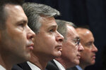 Acting Homeland Security Secretary Kevin McAleenan, left, FBI Director Christopher Wray, second from left, acting Director of the National Counterterrorism Center at the office of the Director of National Intelligence Russell Travers, second from right, and Department of Homeland Security undersecretary for intelligence and analysis David J. Glawe, right, wait to testify before the House Homeland Security Committee on Capitol Hill in Washington, Wednesday, Oct. 30, 2019, during a hearing on domestic terrorism. (AP Photo/Susan Walsh)