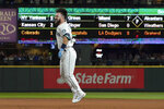 Seattle Mariners' Luis Torrens jumps after he singled to score Jarred Kelenic with the winning run off Texas Rangers pitcher Dennis Santana during the ninth inning of a baseball game Wednesday, Aug. 11, 2021, in Seattle. The Mariners won 2-1. (AP Photo/Ted S. Warren)