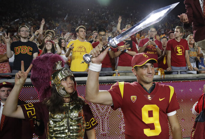 Southern California quarterback Kedon Slovis (9) celebrates after a 45-20 win over Stanford during an NCAA college football game Saturday, Sept. 7, 2019, in Los Angeles. (AP Photo/Marcio Jose Sanchez)
