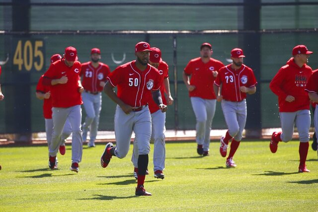 FILE - In this Feb. 17, 2020, file photo, Cincinnati Reds relief pitcher Amir Garrett leads other pitchers in sprints during spring training baseball workouts in Goodyear, Ariz. As one of only two Black players on the Cincinnati Reds, reliever Amir Garrett was afraid to use his platform to speak about racial injustice. That's changed, and he's brought teammates along in pressing for change. (AP Photo/Ross D. Franklin, File)