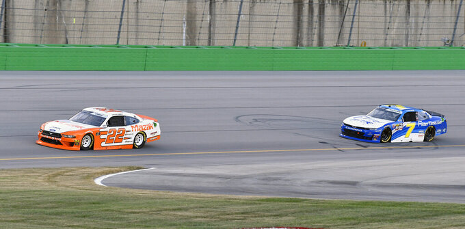 Austin Cindric (22) fights off the challenge from Justin Allgaier (7) during the NASCAR Xfinity Series auto race at Kentucky Speedway in Sparta, Ky., Friday, July 12, 2019. (AP Photo/Timothy D. Easley)