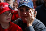 Supporters look on as President Donald Trump arrives to speak at a campaign rally, Friday, Oct. 12, 2018, in Lebanon, Ohio. (AP Photo/Evan Vucci)