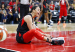 Las Vegas Aces' Liz Cambage reacts after she was called for a foul against the Washington Mystics during the first half of Game 4 of a WNBA playoff basketball series Tuesday, Sept. 24, 2019, in Las Vegas. (AP Photo/John Locher)