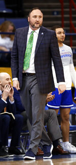 Texas-Arlington coach Chris Ogden reacts to a call during the first half of the team's NCAA college basketball game against Georgia State for the championship of the Sun Belt Conference men's tournament in New Orleans, Sunday, March 17, 2019. Georgia State won 73-64. (AP Photo/Tyler Kaufman)