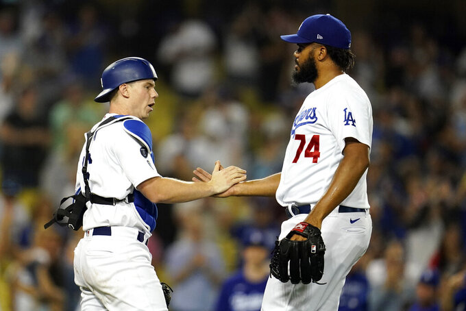 Los Angeles Dodgers catcher Will Smith and relief pitcher Kenley Jansen (74) celebrate the team's 4-3 win over the Pittsburgh Pirates in a baseball game Tuesday, Aug. 17, 2021, in Los Angeles. (AP Photo/Marcio Jose Sanchez)
