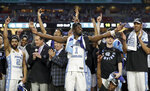 FILE - In this April 3, 2017, file photo, North Carolina's Theo Pinson (1) and the rest of the team celebrate after the championship game against Gonzaga at the Final Four NCAA college basketball tournament in Glendale, Ariz. North Carolina won 71-65. (AP Photo/David J. Phillip, File)