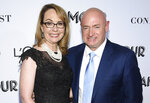 FILE- In this Nov. 12, 2018, file photo politician and gun control advocate Gabrielle Giffords and husband, retired astronaut Mark Kelly, attend the Glamour Women of the Year Awards at Spring Studios in New York. Kelly is kicking off his U.S. Senate campaign Saturday, Feb. 23, 2019 with a rally in Tucson. (Photo by Evan Agostini/Invision/AP, File)