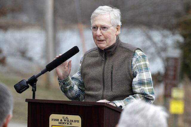 Senate Majority Leader Mitch McConnell, R-Ky., speaks after watching Asian carp being harvested from Kentucky Lake near Golden Pond, Ky., Monday, Feb. 17, 2020. The harvest method mainly targets bighead and silver carp, two of the four invasive carp species collectively known as Asian carp in the U.S. Both bighead and silver carp devour plankton that form the base of the food chains, grow rapidly and reproduce prolifically, outcompeting many native fish. (AP Photo/Mark Humphrey)