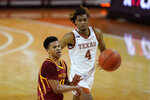 Iowa State guard Rasir Bolton passes ahead of Texas forward Greg Brown (4) during the second half of an NCAA college basketball game, Tuesday, Jan. 5, 2021, in Austin, Texas. (AP Photo/Eric Gay)
