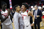 Rutgers guard Jacob Young, left, and guard Geo Baker, center, celebrate after defeating Ohio State 64-61 during an NCAA college basketball game, Wednesday, Jan. 9, 2019, in Piscataway, N.J. (AP Photo/Julio Cortez)