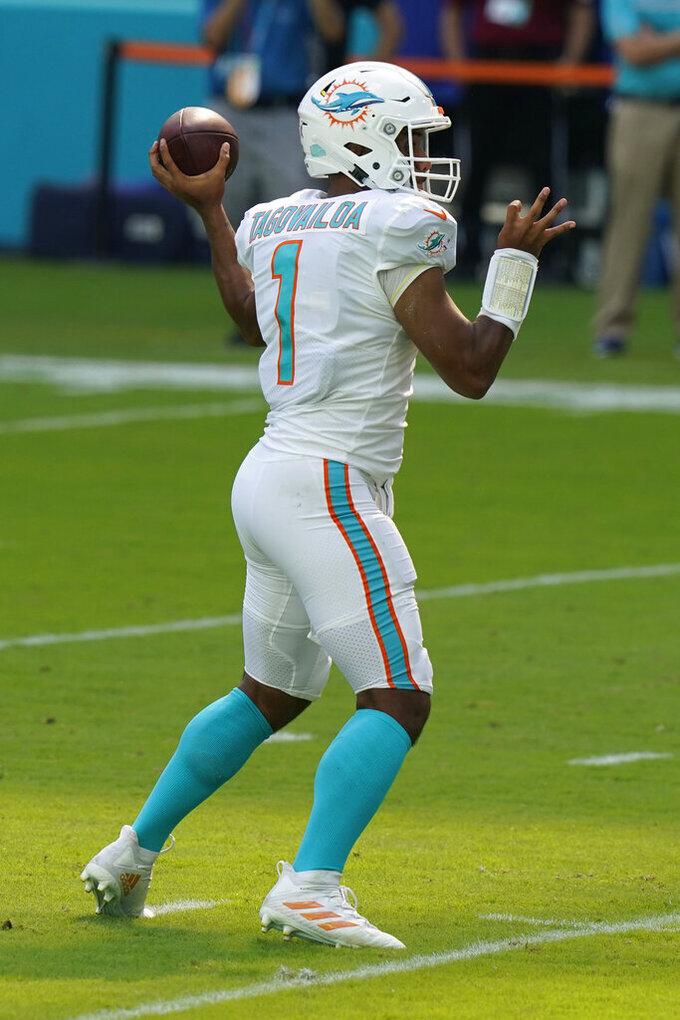 Miami Dolphins quarterback Tua Tagovailoa (1) throws his first career touchdown pass, during the first half of an NFL football game against the Los Angeles Rams, Sunday, Nov. 1, 2020, in Miami Gardens, Fla. (AP Photo/Lynne Sladky)