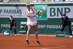 Russia's Anastasia Pavlyuchenkova returns the ball to Slovenia's Tamara Zidansek during their semifinal match of the French Open tennis tournament at the Roland Garros stadium Thursday, June 10, 2021 in Paris. (AP Photo/Michel Euler)