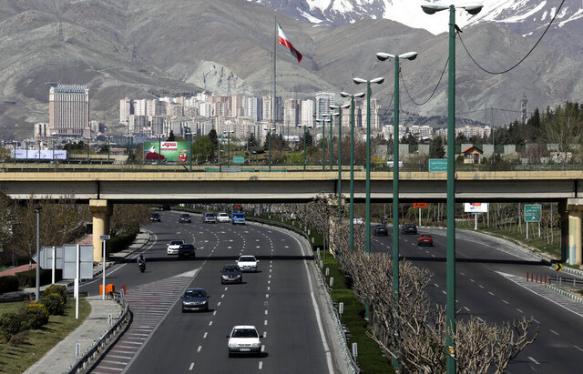 Cars drive in a highway in northern Tehran, Iran, Friday, March 20, 2020, on the first day of Iranian New Year, called Nowruz, or