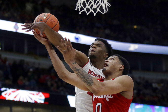 Nebraska's James Palmer Jr. (0) gets fouled by Wisconsin's Khalil Iverson during the second half of an NCAA college basketball game in the quarterfinals of the Big Ten Conference tournament, Friday, March 15, 2019, in Chicago. (AP Photo/Kiichiro Sato)