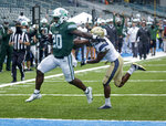 Tulane running back Cameron Carroll (20) scores against Navy cornerback Michael McMorris (5) during the first half of an NCAA college football game, Saturday, Sept. 19, 2020, in New Orleans. (Scott Threlkeld/The Times-Picayune/The New Orleans Advocate)