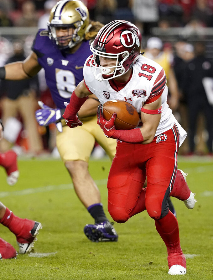 Utah wide receiver Britain Covey (18) carries against Washington during the first half of the Pac-12 Conference championship NCAA college football game in Santa Clara, Calif., Friday, Nov. 30, 2018. (AP Photo/Tony Avelar)