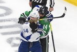 Dallas Stars left wing Jamie Benn (14) gets his glove over the face of Tampa Bay Lightning defenseman Jan Rutta (44) during the third period of Game 3 of the NHL hockey Stanley Cup Final, Wednesday, Sept. 23, 2020, in Edmonton, Alberta. (Jason Franson/The Canadian Press via AP)