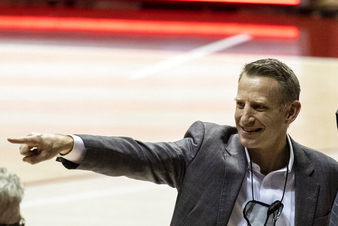 Alabama head coach Nate Oats salutes the fans after an NCAA college basketball game against Auburn, Tuesday, March 2, 2021, in Tuscaloosa, Ala. Alabama won the regular season Southeastern Conference championship. (AP Photo/Vasha Hunt)
