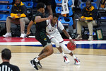 Gonzaga guard Joel Ayayi (11) drives on Norfolk State guard Devante Carter (14) during the first half of a men's college basketball game in the first round of the NCAA tournament at Bankers Life Fieldhouse in Indianapolis, Saturday, March 20, 2021. (AP Photo/Paul Sancya)