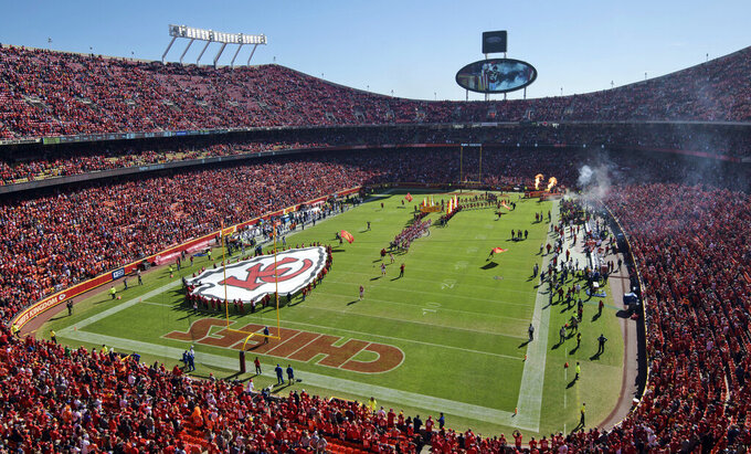 FILE - In this Oct. 28, 2018, file photo, fans fill Arrowhead Stadium as the Kansas City Chiefs run onto the field before an NFL game against the Denver Broncos in Kansas City, Mo. A state panel in Missouri has ruled that the Kansas City Chiefs owe $930,000 in back tax plus interest on the decade-old Arrowhead Stadium renovation. (AP Photo/Reed Hoffmann, File)
