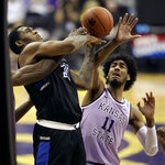 Saint Louis' Jimmy Bell Jr., left, and Kansas State's Antonio Gordon (11) battle for a rebound during the second half of an NCAA college basketball game Saturday, Dec. 21, 2019, in Kansas City, Mo. (AP Photo/Charlie Riedel)