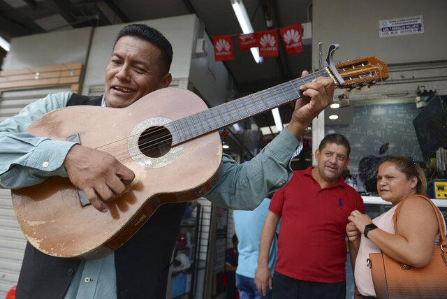 Street musician Angel Alvarado, known as