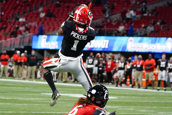 Georgia wide receiver George Pickens (1) makes a touchdown catch against Cincinnati during the first half of the Peach Bowl NCAA college football game, Friday, Jan. 1, 2021, in Atlanta. (AP Photo/Brynn Anderson)