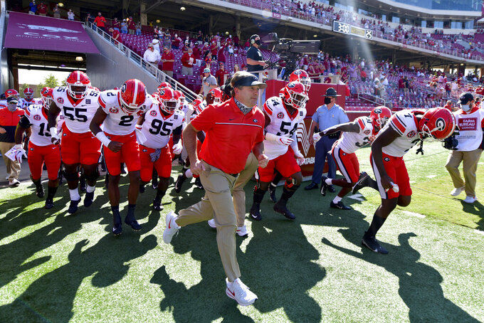 Georgia coach Kirby Smart leads the team onto the field before an NCAA college football game against Arkansas in Fayetteville, Ark., Saturday, Sept. 26, 2020. (AP Photo/Michael Woods)