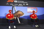 Ferrari drivers Sebastian Vettel of Germany, right and Charles Leclerc of Monaco speak during a news conference at the Red Bull Ring racetrack in Spielberg, Austria, Thursday, July 9, 2020. Styrian Formula One Grand Prix will be held on Sunday. (Bryn Lennon/Pool via AP)