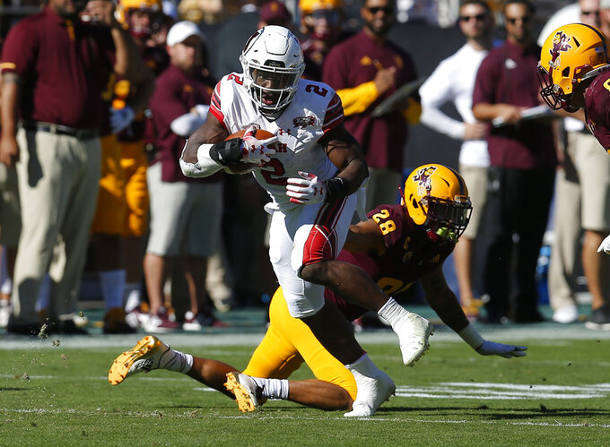 Utah running back Zack Moss (2) breaks a tackle by Arizona State defensive back Demonte King in the first half during an NCAA college football game, Saturday, Nov. 3, 2018, in Tempe, Ariz. (AP Photo/Rick Scuteri)