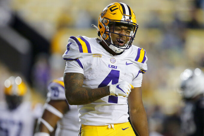 LSU running back John Emery Jr. (4) celebrates after scoring a touchdown against South Carolina during the second half of an NCAA college football game in Baton Rouge, La., Saturday, Oct. 24, 2020. (AP Photo/Brett Duke)
