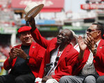 FKILE - In this Saturday, June 17, 2017, file photo, former Cincinnati Reds player Joe Morgan waves to the crowd as he attends a statue dedication ceremony for teammate Pete Rose before a baseball game between the Cincinnati Reds and the Los Angeles Dodgers, in Cincinnati. Joe Morgan has died. A family spokesman says he died at his home Sunday, Oct. 11, 2020, in Danville, Calif.(AP Photo/John Minchillo)