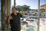 FILE - In this Oct. 23, 2019 file photo, Developer Danny Gaekwad shows the view from the gym that overlooks the intersection of Silver Springs Blvd  in Ocala, Fla.  Since the coronavirus crisis started, hotel owners say they are struggling to get relief on a type of loan that Wall Street investors buy.  [Doug Engle/Ocala Star-Banner via AP)
