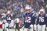 New England Patriots quarterback Tom Brady (12) walks off the field after throwing an interception to end the Patriots chances against the Tennessee Titans in an NFL wild-card playoff game, Saturday, Jan. 4, 2020 in Foxborough, Mass. The Titans defeated the Patriots 20-13. (Margaret Bowles via AP)