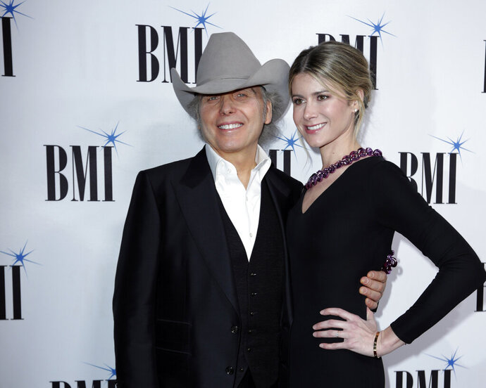Dwight Yoakam, left, and Emily Joyce arrive at 67th Annual BMI Country Awards ceremony at BMI Music Row offices on Tuesday, Nov. 12, 2019, in Nashville, Tenn. (Photo by Al Wagner/Invision/AP)