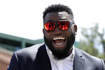 FILE - In this June 22, 2017, file photo, retired Boston Red Sox designated hitter David Ortiz, smiles outside Fenway Park in Boston. Ortiz returned to Boston for medical care after being shot in a bar Sunday, June 9, 2019, in his native Dominican Republic. (AP Photo/Charles Krupa, File)