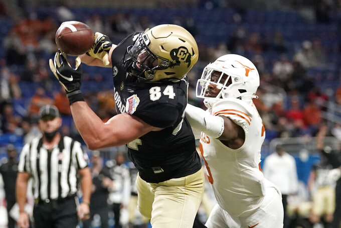 Texas defensive back Jalen Green (3) breaks up a pass intended for Colorado tight end Matt Lynch (84) during the first half of the Alamo Bowl NCAA college football game Tuesday, Dec. 29, 2020, in San Antonio. (AP Photo/Eric Gay)