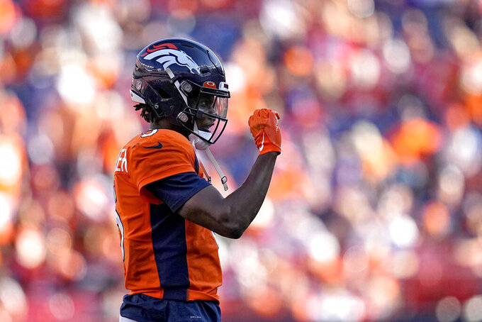 Denver Broncos quarterback Teddy Bridgewater (5) motion to his bench during the second half of an NFL football game abasing the New York Jets, Sunday, Sept. 26, 2021, in Denver. (AP Photo/Jack Dempsey)