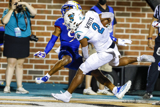 Coastal Carolina running back Reese White (2) runs for a touchdown against Kansas cornerback Jeremy Webb (9) during the second half of an NCAA college football game in Conway, S.C., Friday, Sept. 10, 2021. Coastal Carolina won 49-22. (AP Photo/Nell Redmond)