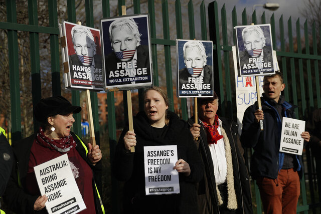 "Supporters of Julian Assange hold placards as they protest on the second day of a week of opening arguments for the extradition of Wikileaks founder Julian Assange outside Belmarsh Magistrates' Court in south east London, Tuesday, Feb. 25, 2020. U.S. authorities, want to try Assange on espionage charges. A lawyer for the Americans said the Australian computer expert was an ""ordinary"" criminal whose publication of hundreds of thousands of secret military documents put many people at risk of torture and death. (AP Photo/Matt Dunham)"
