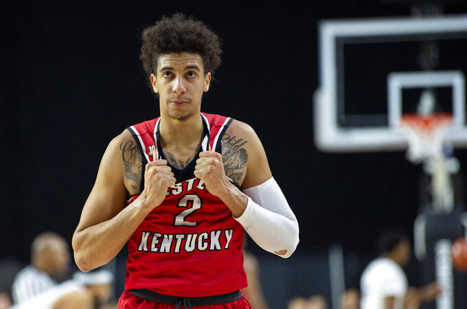 Western Kentucky guard Jared Savage (2) looks up at the clock in the final seconds of the team's NCAA college basketball game against Old Dominion for the Conference USA men's tournament championship, Saturday, March 16, 2019, in Frisco, Texas. Old Dominion won 62-56. (AP Photo/Jeffrey McWhorter)